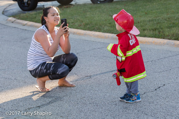 mom take picture of toddler dressed as a fireman
