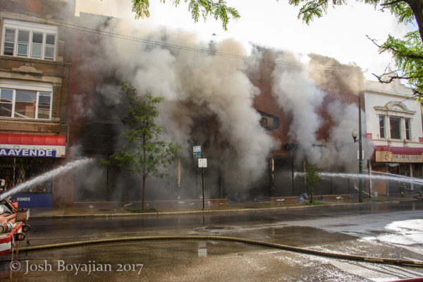 heavy smoke from the front of a commercial building fire