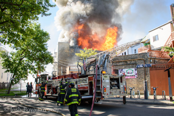massive flames erupt from building on fire
