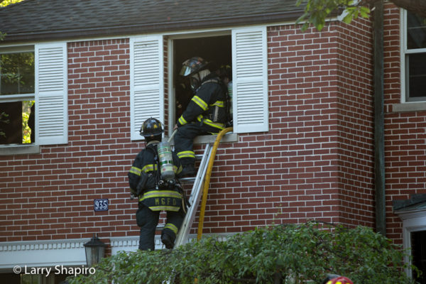 Firefighters on ladder at second floor window