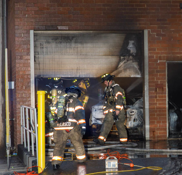 firefighters at commercial building fire