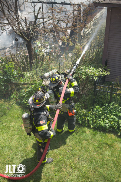 firefighters with hose line
