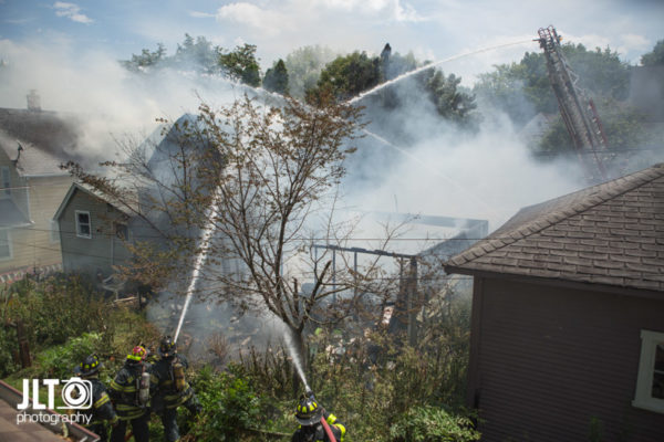 hose lines and master stream at fire scene