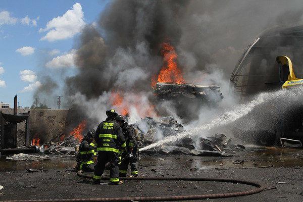 Chicago firefighters battle fire in a junkyard