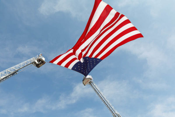 American flag suspended from fire truck