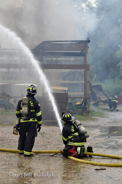 firefighters battling a warehouse fire