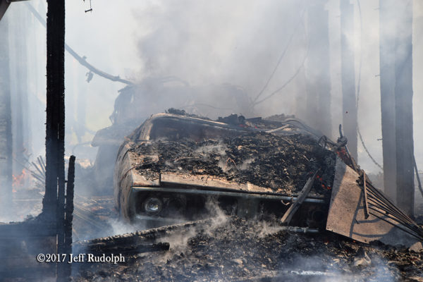 car inside garage destroyed by fire