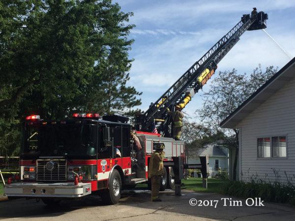 HME fire truck at fire scene