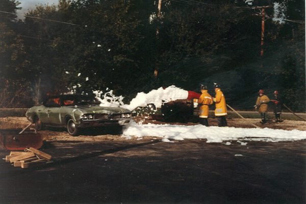 vintage photo of firefighters training with high expansion foam