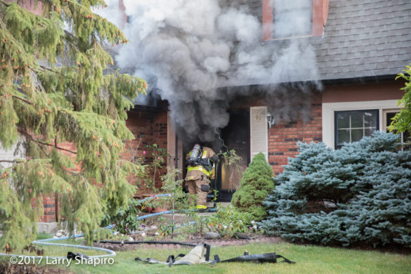 firefighter enters house on fire