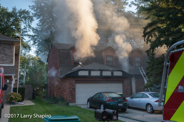 heavy smoke pushes from house on fire