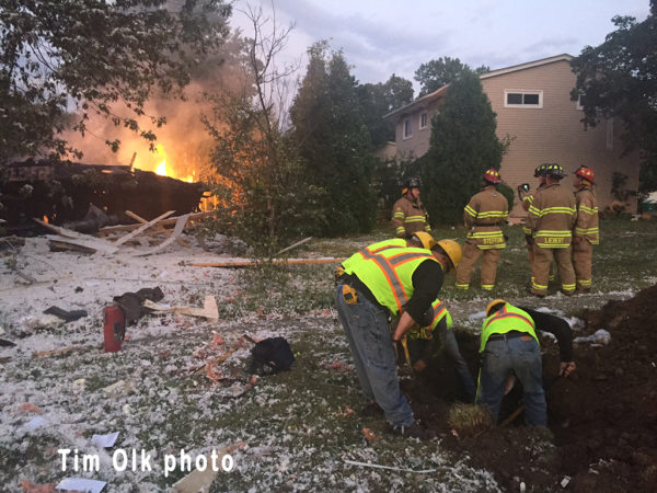 gas utility workers at scene of house explosion