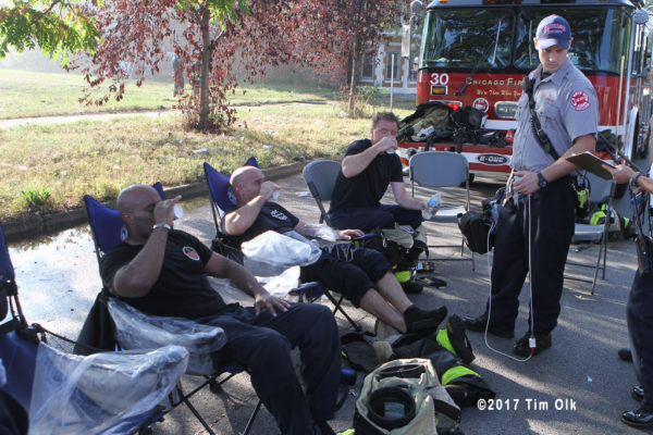 firefighters cool down and rehab after a fire