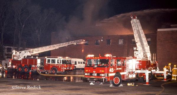 vintage Pierce fire trucks at fire scene