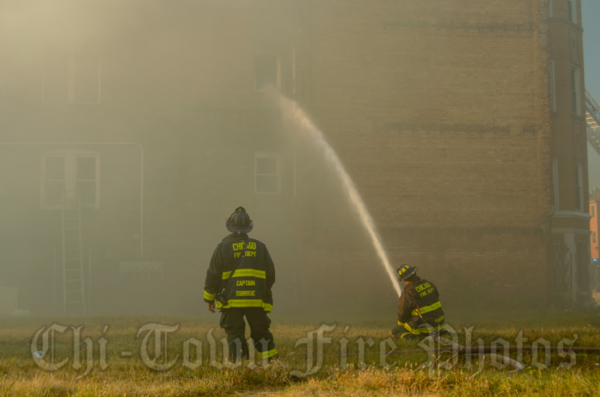 firefighters immersed in smoke at fire scene