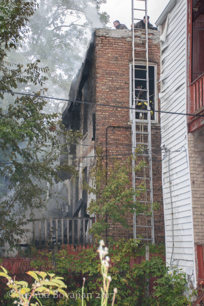 ground ladder to window of fire building