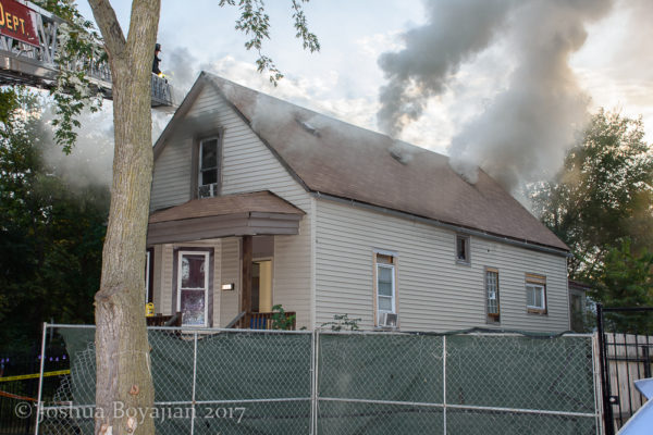 smoke vents from roof of house on fire