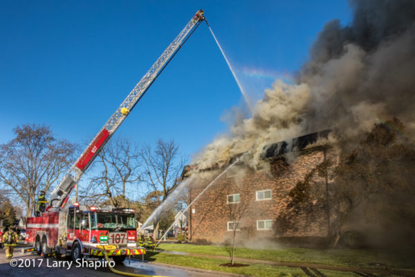 Bensenville FPD E-ONE Cyclone II HP100 aerial ladder battling an apartment building fire