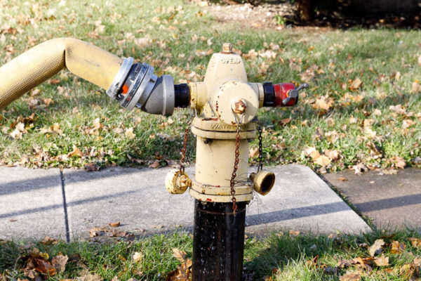 fire hydrant with hose attached
