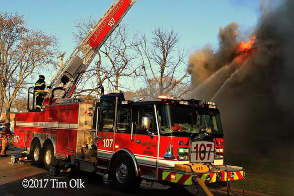 Bensenville FPD Truck 107 battling an apartment building fire