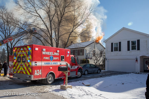 smoke and flames from house fire in the winter