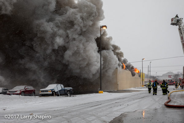 massive smoke column from commercial building fire