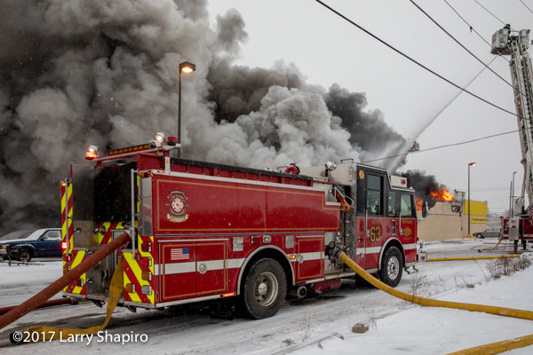 Pierce fire engine at fire with smoke and flames