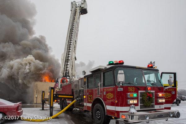 Pierce tower ladder battles commercial building fire