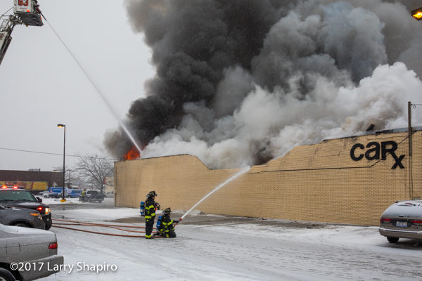 wall collapses during commercial building fire