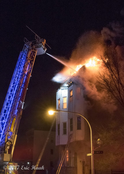 E-ONE tower ladder battles fire at night