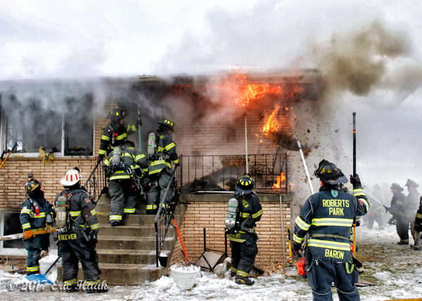 smoke and flames as firefighters battle house fire