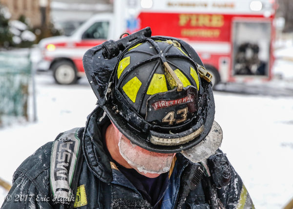 firefighter at winter fire scene