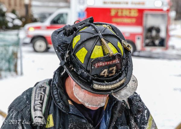 firefighter at winter fire scene