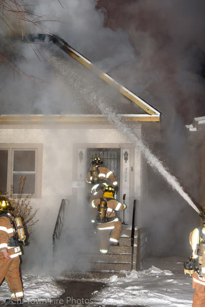 firefighters attack house fire at night