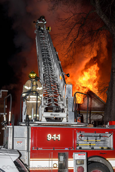 Seagrave ladder truck at work with big flames