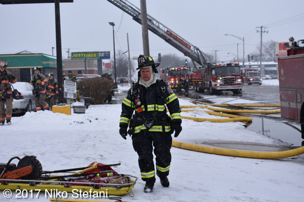 firefighter at fire scene in PPE