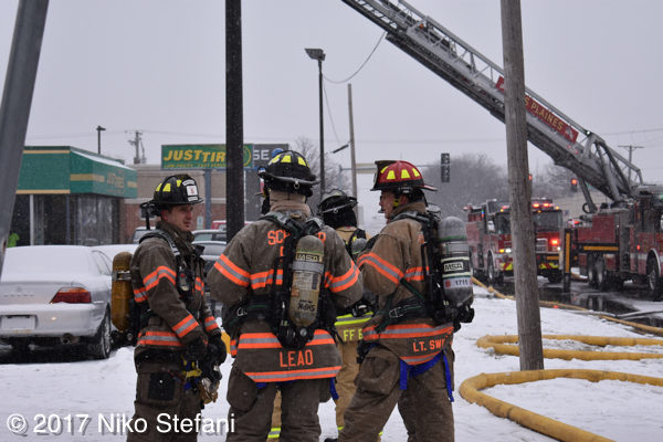 firefighters in PPE at fire scene
