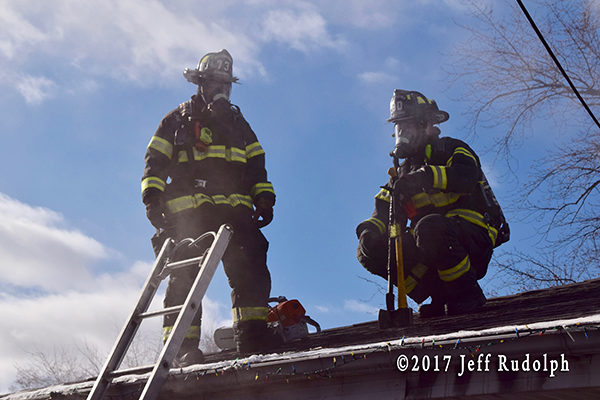 firefighters in PPE on the roof