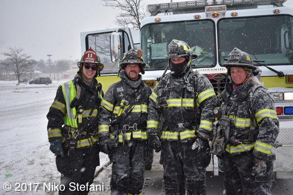 firefighters posing after battling a winter fire