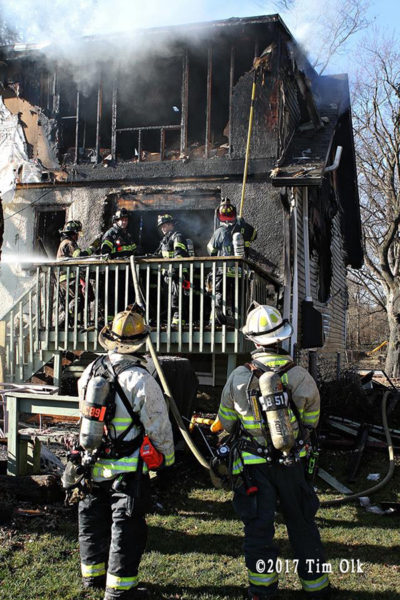 firefighters overhaul house fire in Lisle IL