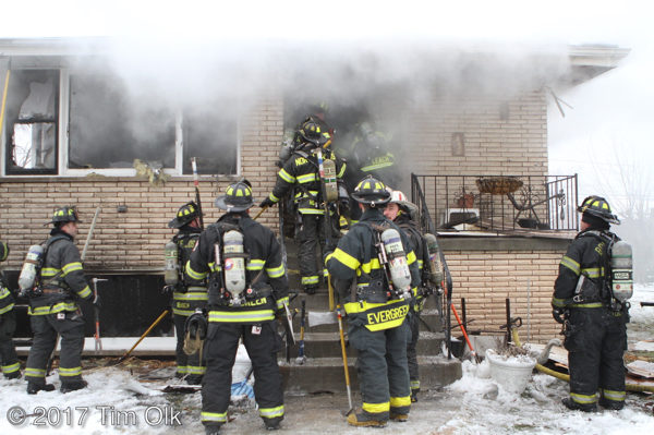 firefighters battle house fire with smoke