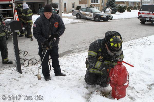firefighters thaw frozen hydrant