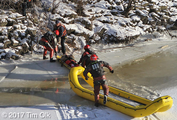 FD divers rescue a victim from a frozen river