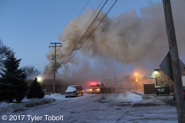 heavy smoke and flames from commercial fire in Crystal Lake