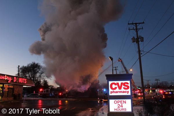 heavy smoke from commercial fire in Crystal Lake