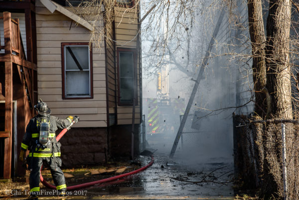 firefighter with hose line at fire