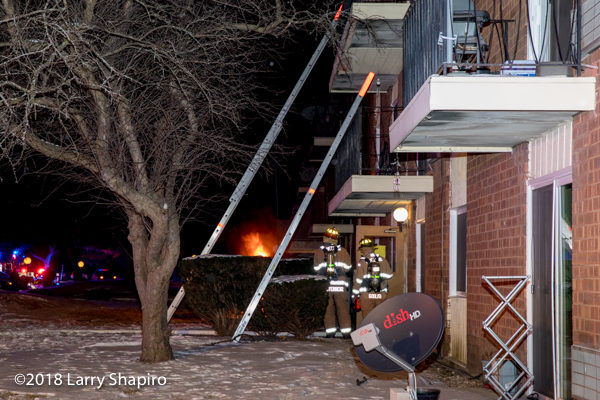 ground ladders to multiple balconies at apartment fire