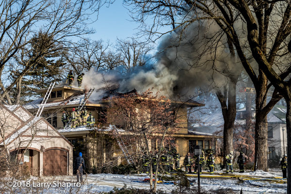 heavy smoke and flames from house on fire