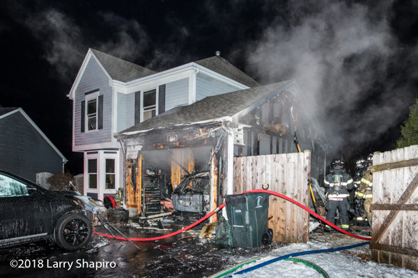 attached garage destroyed by fire in Mundelein