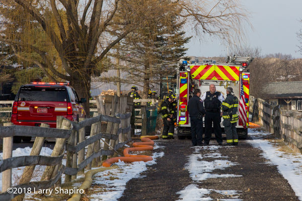 fire trucks at barn fire